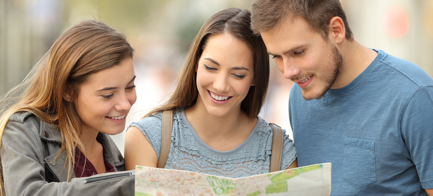 Friends looking at a map on a getaway in Marblehead