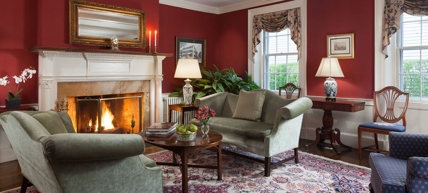 Common area with fireplace and seating at our Hotel in Marblehead
