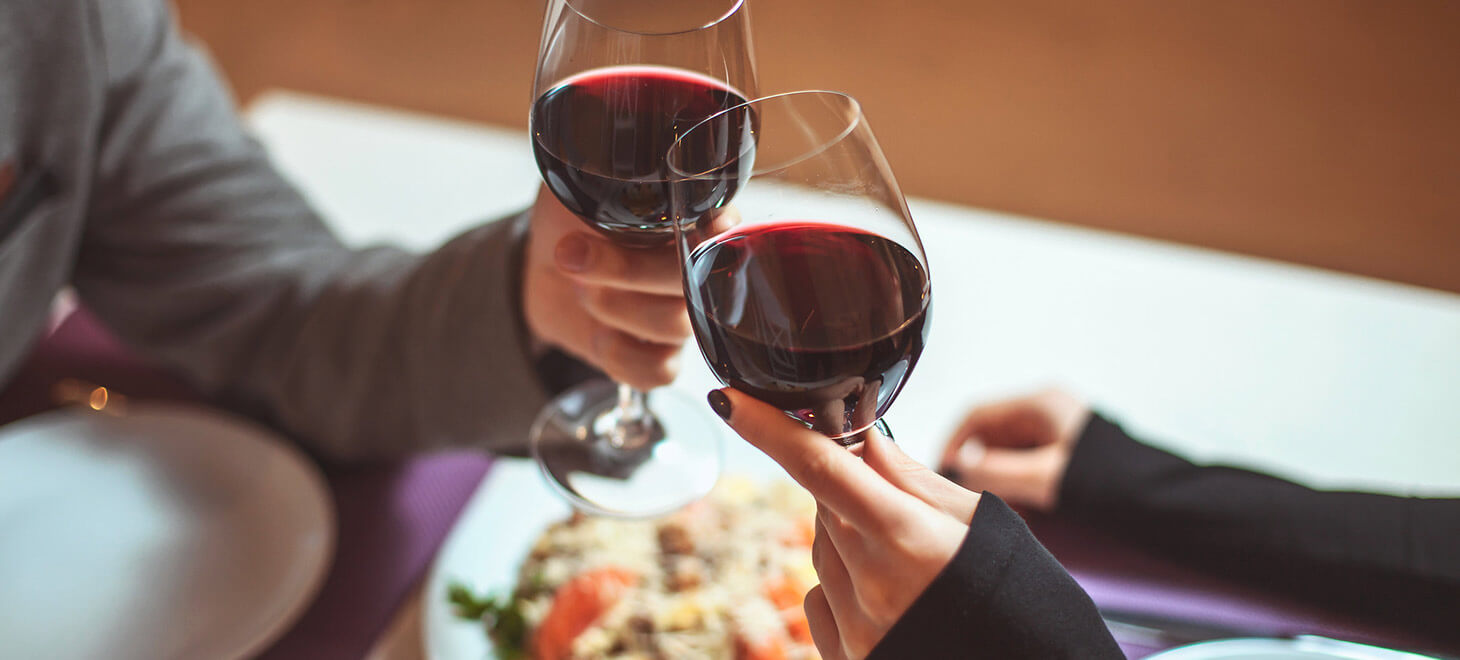 Couple toasting with wine at a restaurant in Marblehead