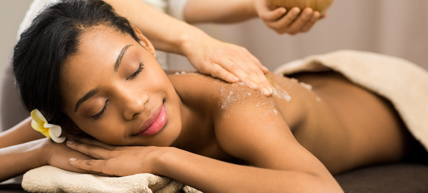 Woman enjoying a scrub massage in Marblehead