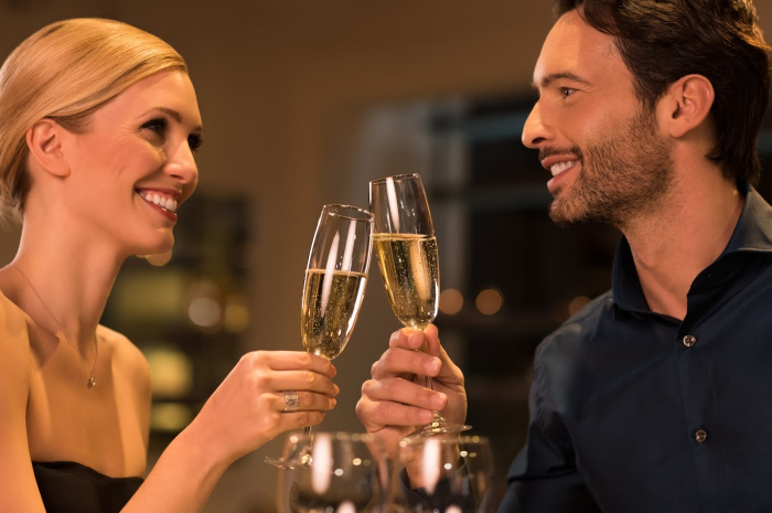 Couple smiling and holding Champagne glasses