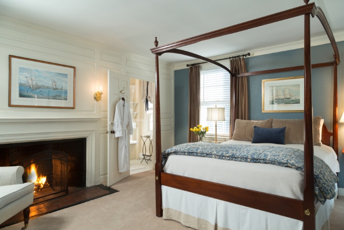 Room 28 at Harbor Light Inn with queen bed and fireplace