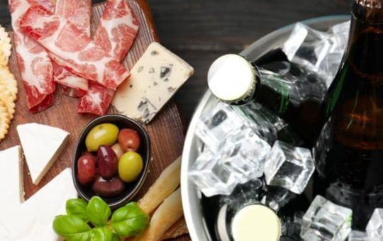 beers on ice and cheese and meat board